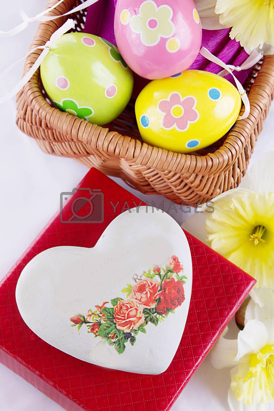 Royalty free image of Easter decoration with eggs, flowers and heart by Angel_a