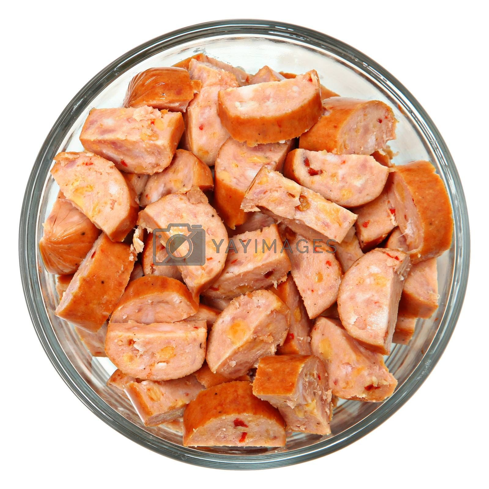 Royalty free image of Spicy Cheese Filled Chipotle Sausages Chopped in Bowl by duplass