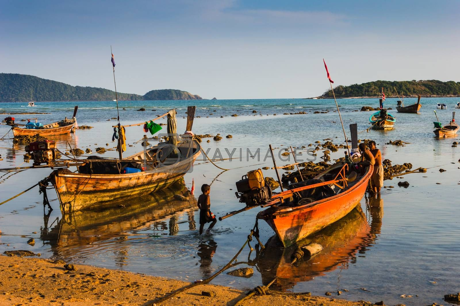 Royalty free image of Fishing boats on the sea shore in Thailand by oleg_zhukov