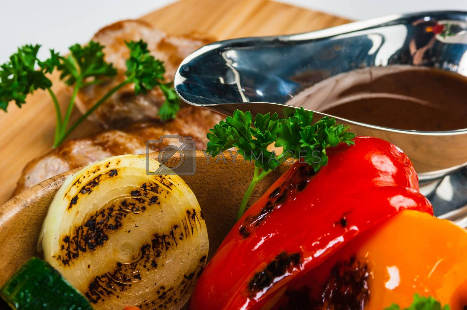 Royalty free image of Grilled pork with baked vegetables by oleg_zhukov