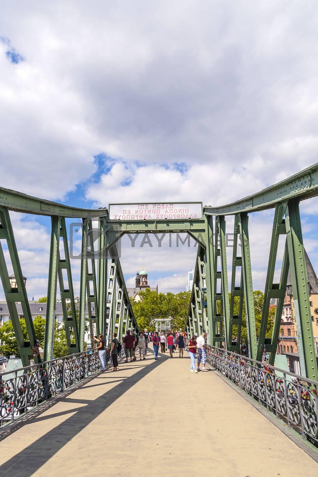 Royalty free image of people on bridge eiserner Steg in Frankfurt, Germany. by meinzahn