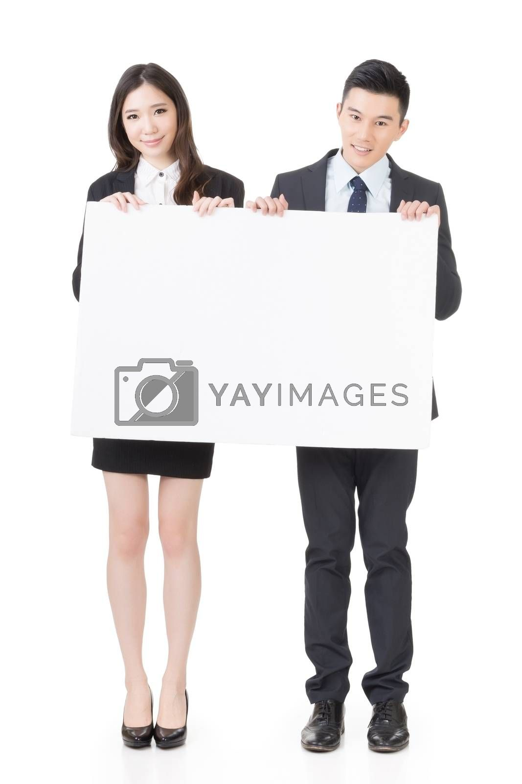 Royalty free image of Business man and woman holding blank white board by elwynn
