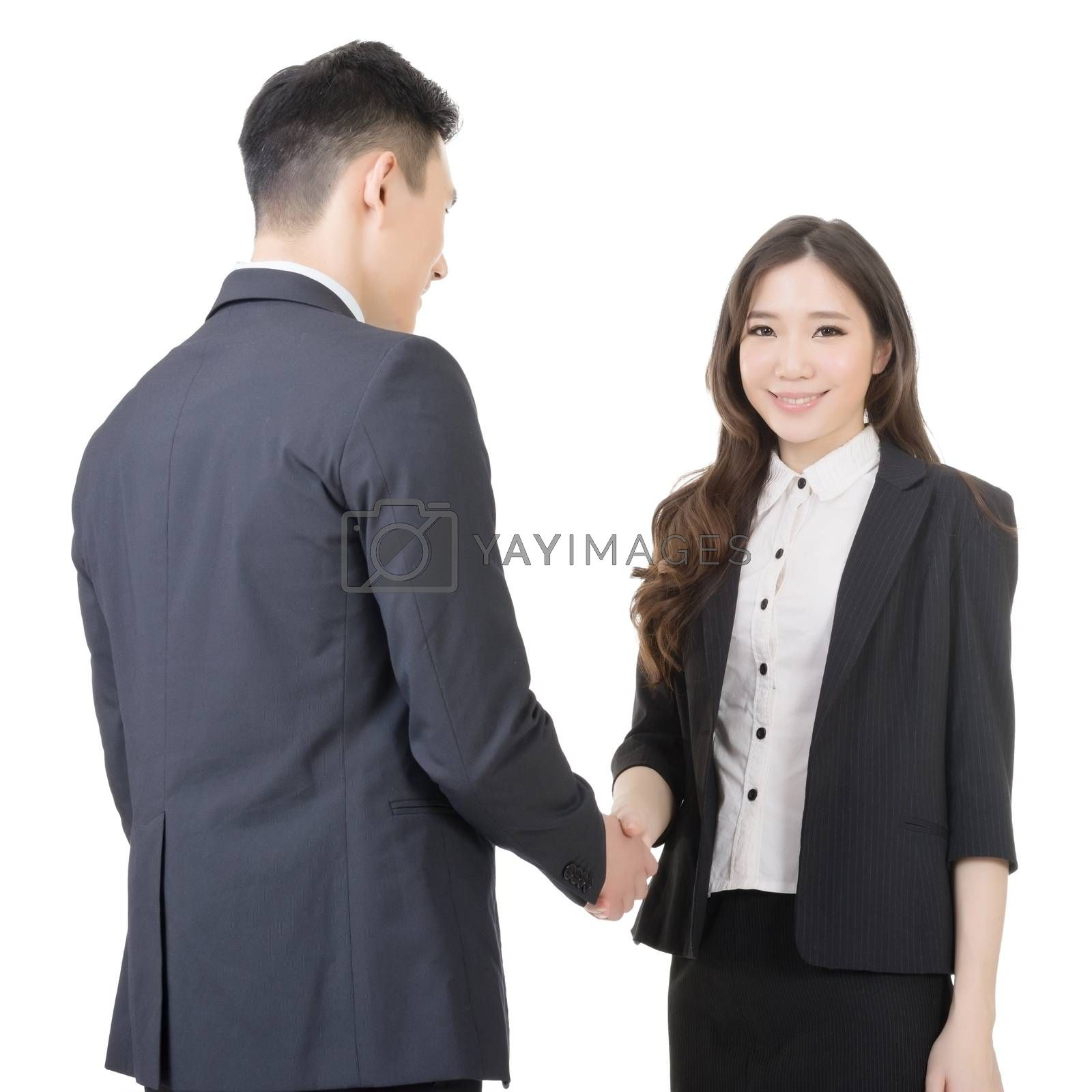 Royalty free image of Business woman and man shake hands by elwynn