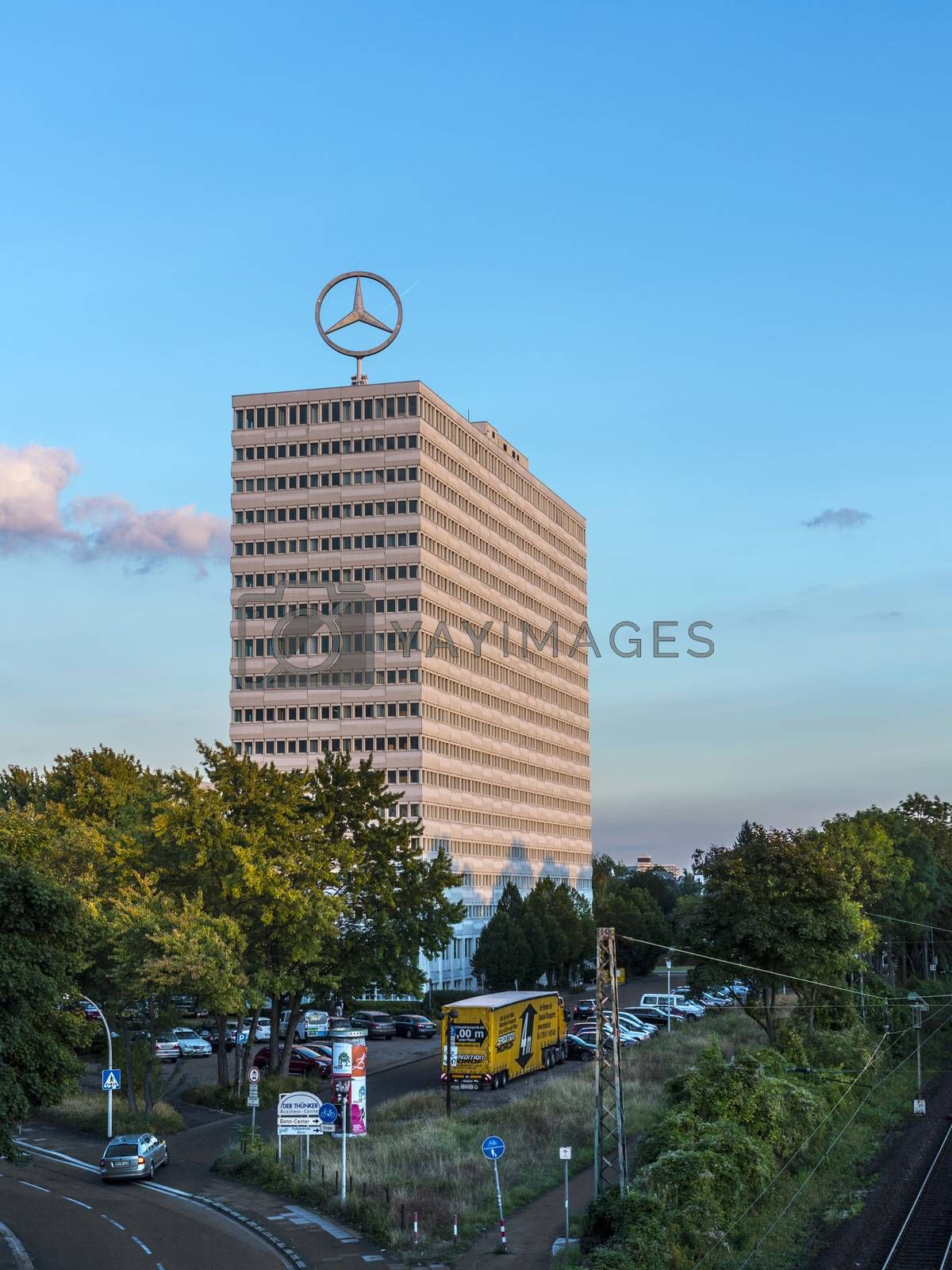 Royalty free image of image of the Mercedes Benz logo on the rooftop of a high rise bu by meinzahn