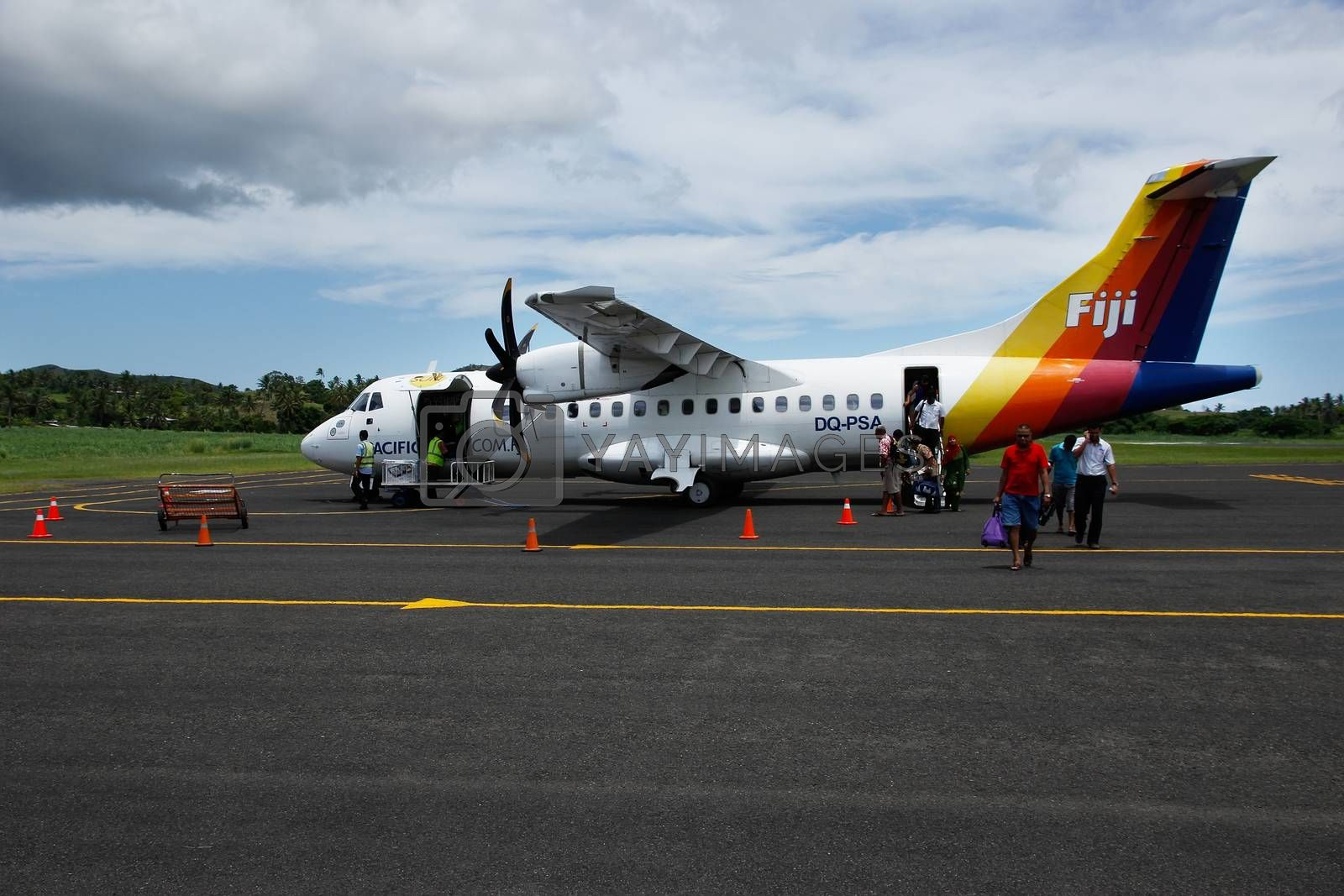 Royalty free image of Passangers getting out of Pacific Sun airplane, Labasa airport,  by donya_nedomam