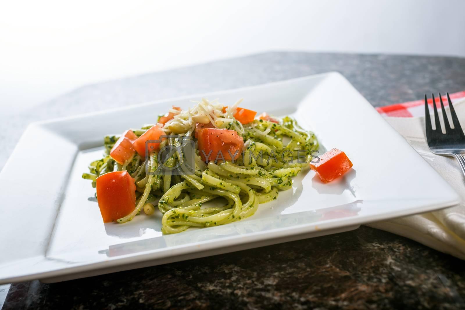 Royalty free image of Fettucini pasta with pesto sauce by Boyrcr420
