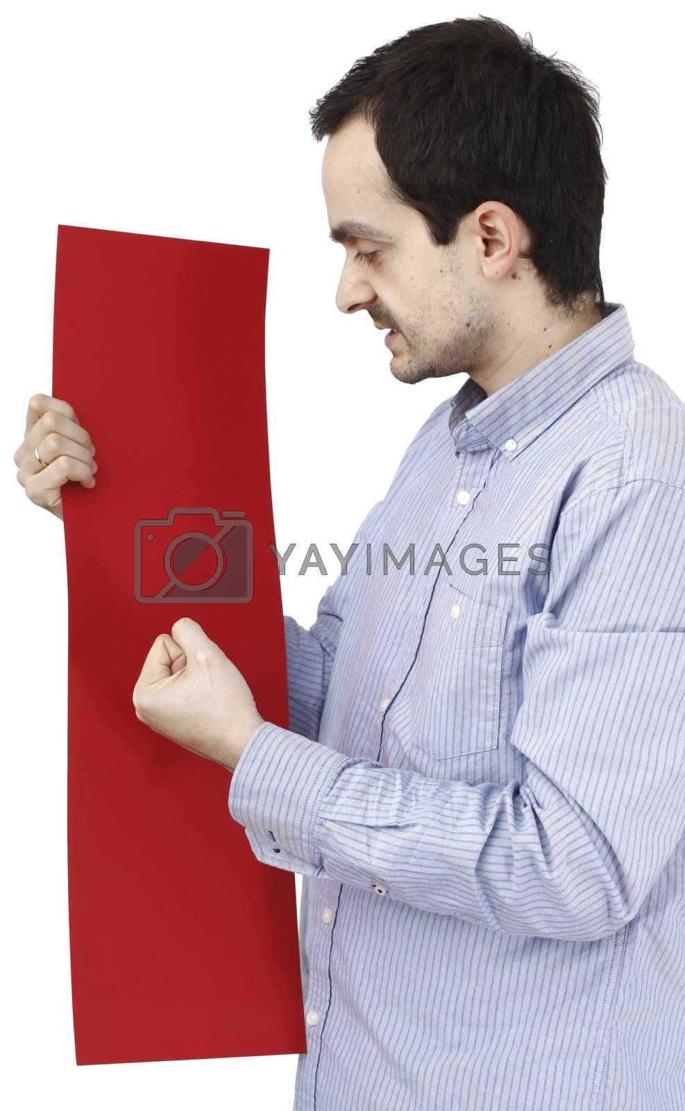 Young man holding a blank piece of paper