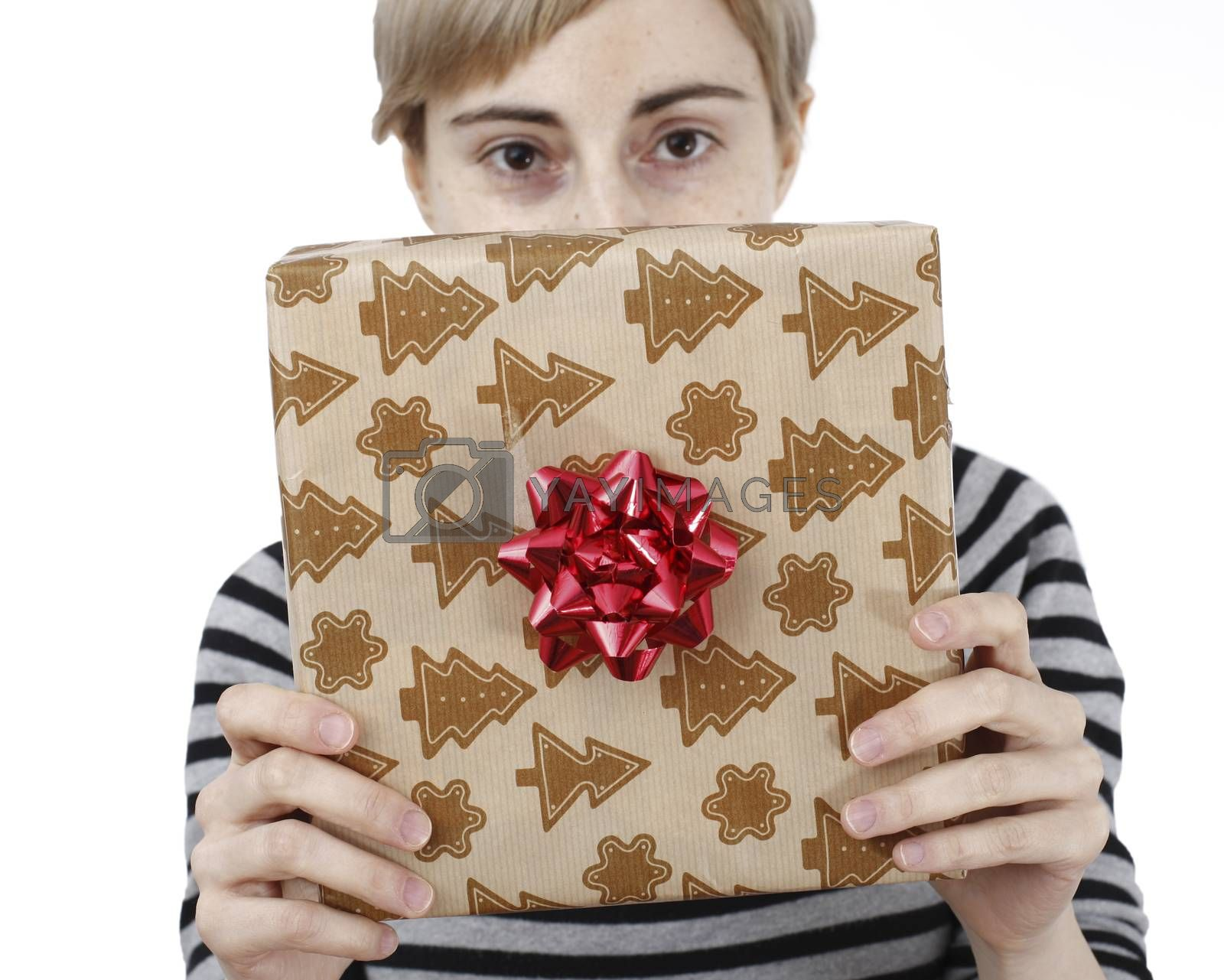 Young woman holding a present in hands
