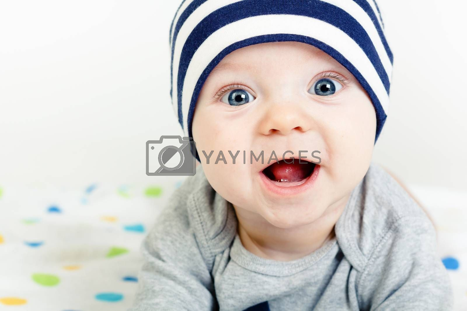 Funny cute blue-eyed baby. Little happy boy