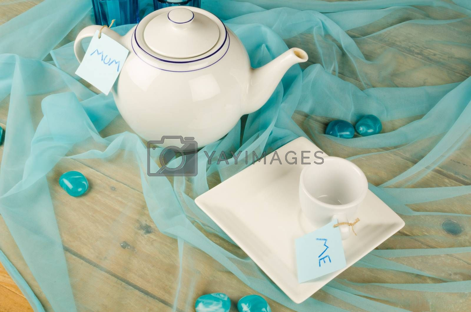Till life with tea pot and cup as a mothers day concept