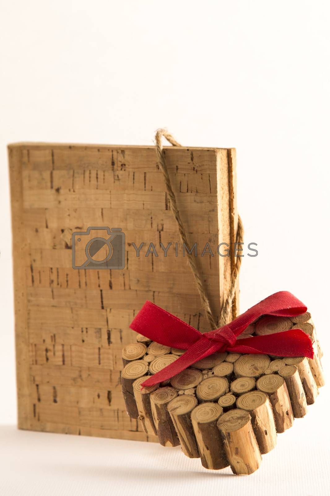 Red ribbon vintage dirty heart on cork book