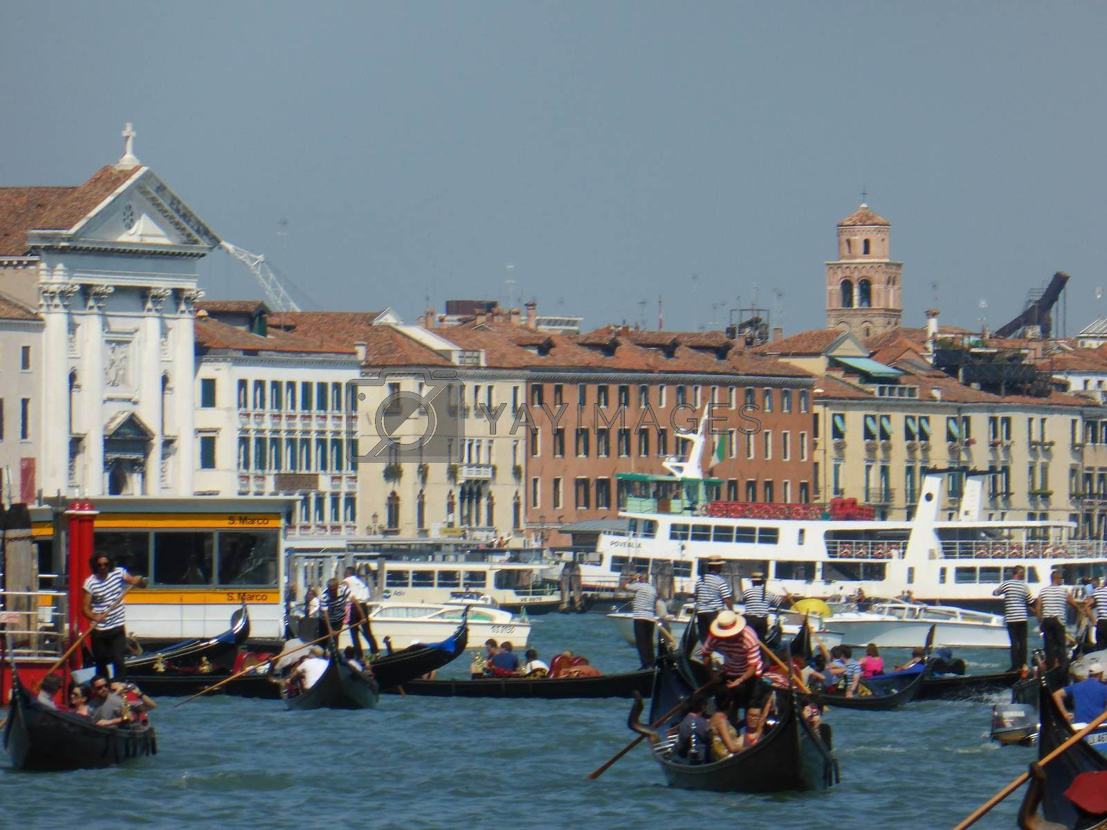 Venice, Italy ��� July, 2013:  the Festival of the Redeemer in Venice on July 20, 2013. The Venetians��� favourite event is a thanksgiving to Jesus Christ for the end of the Plague. In three years 1575-1577 the Black Death killed more than half of the inhabitants of Venice in spite of the efforts of the best doctors and the Venetian Senate approved the proposal of the Doge to make a solemn vow to invoke the salvation of the city. The fireworks show is considered the best in Europe and people can watch having dinner on boats or gondole.