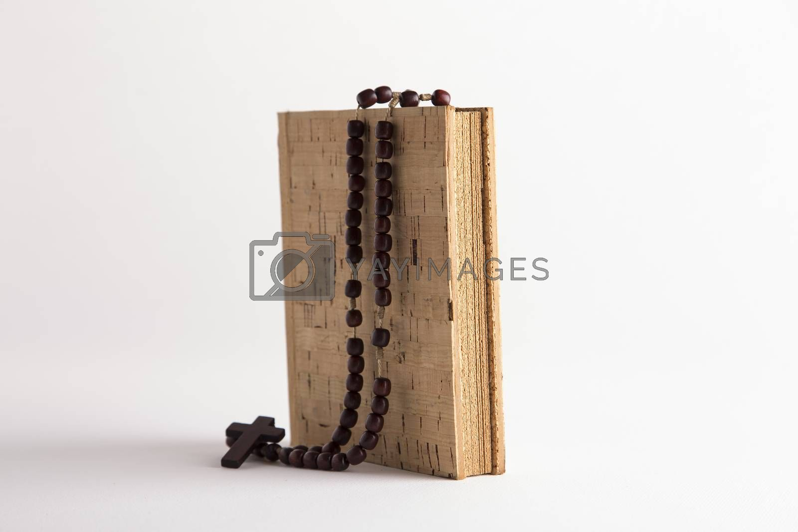 Holy Rosary necklace on cork book