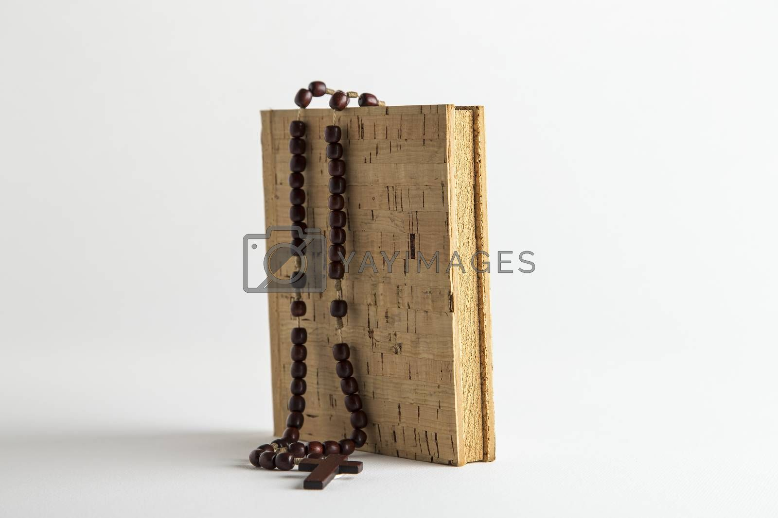 Holy Rosary necklace on blank cork book