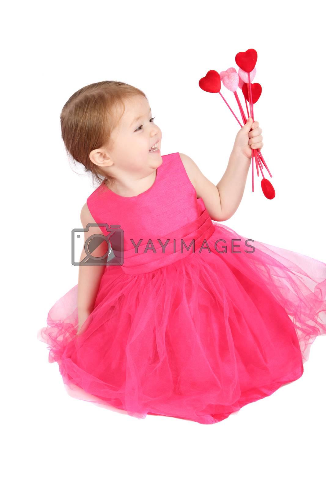 Little girl holding valentine hearts on white