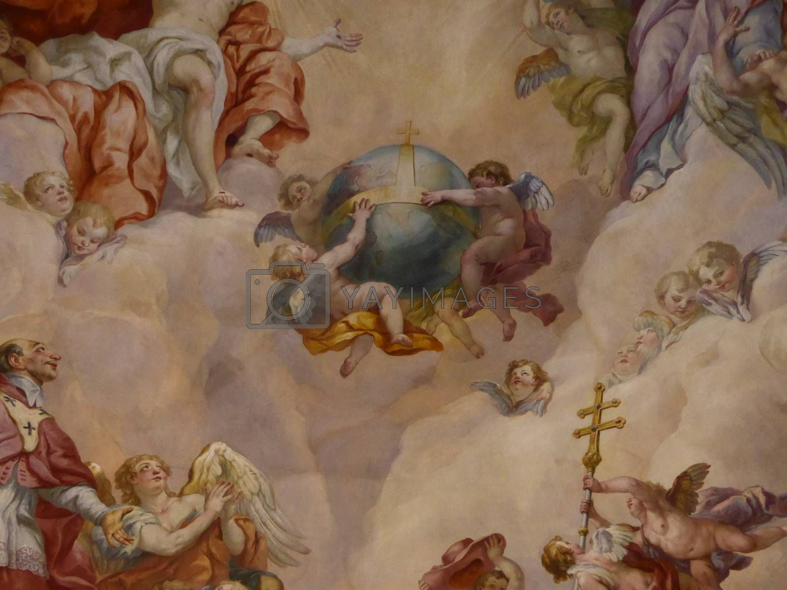 Vienna, Austria – August 27, 2013:  Ceiling frescoes by Johann Michael Rottmayr in the Karlskirche in Vienna on August 27, 2013. The Venna's finest baroque church was built because of a solemn vow made by Emperor Charles VI to invoke St. Charles for protecting the city struck in 1713 by a terrible epidemic of plague. It's considered a piece of Rome outside Italy