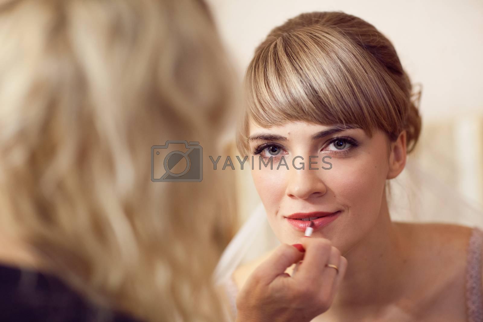 girl applying wedding make-up by professional make-up artist