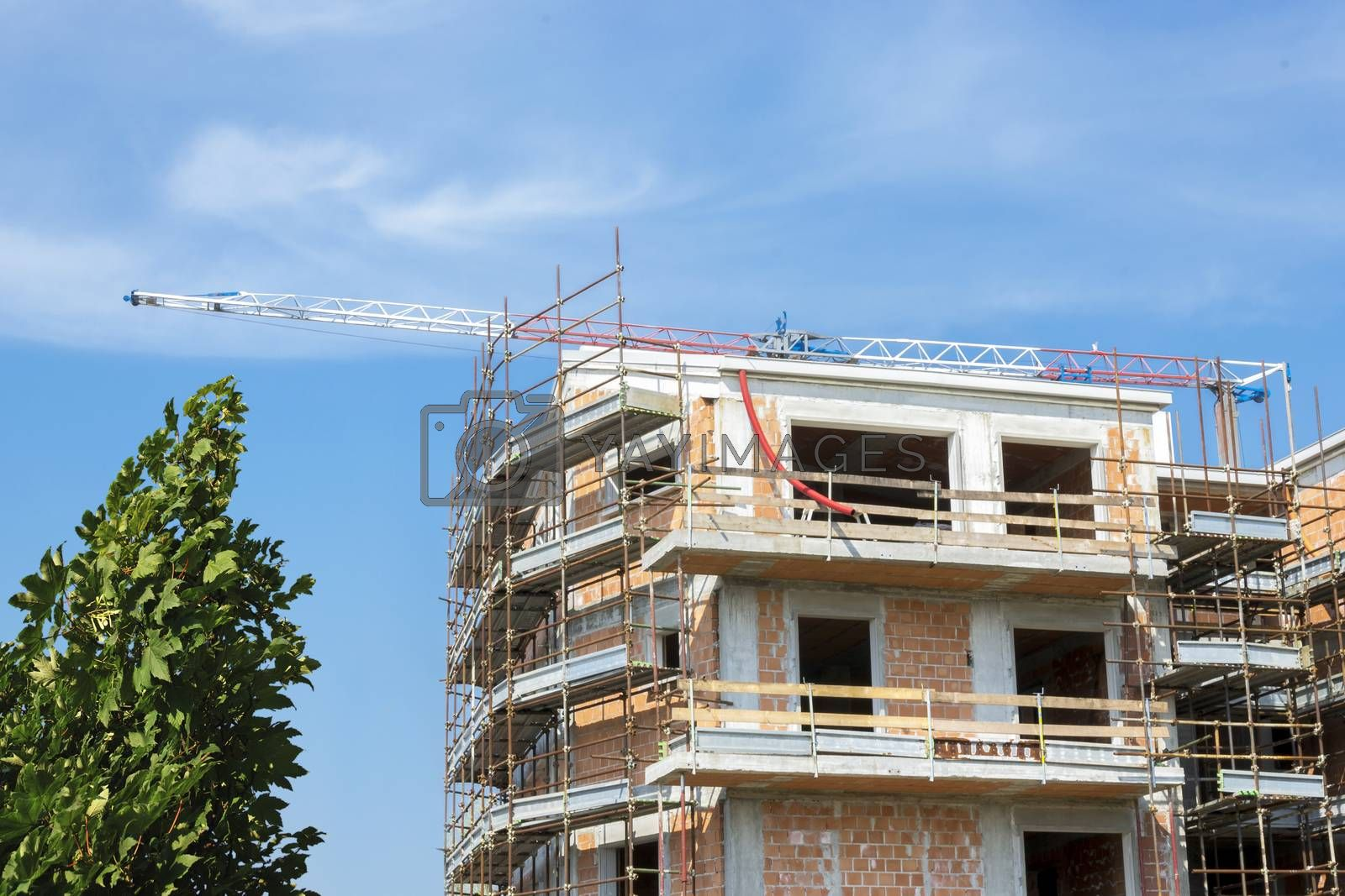 Royalty free image of new apartments under construction by enrico.lapponi