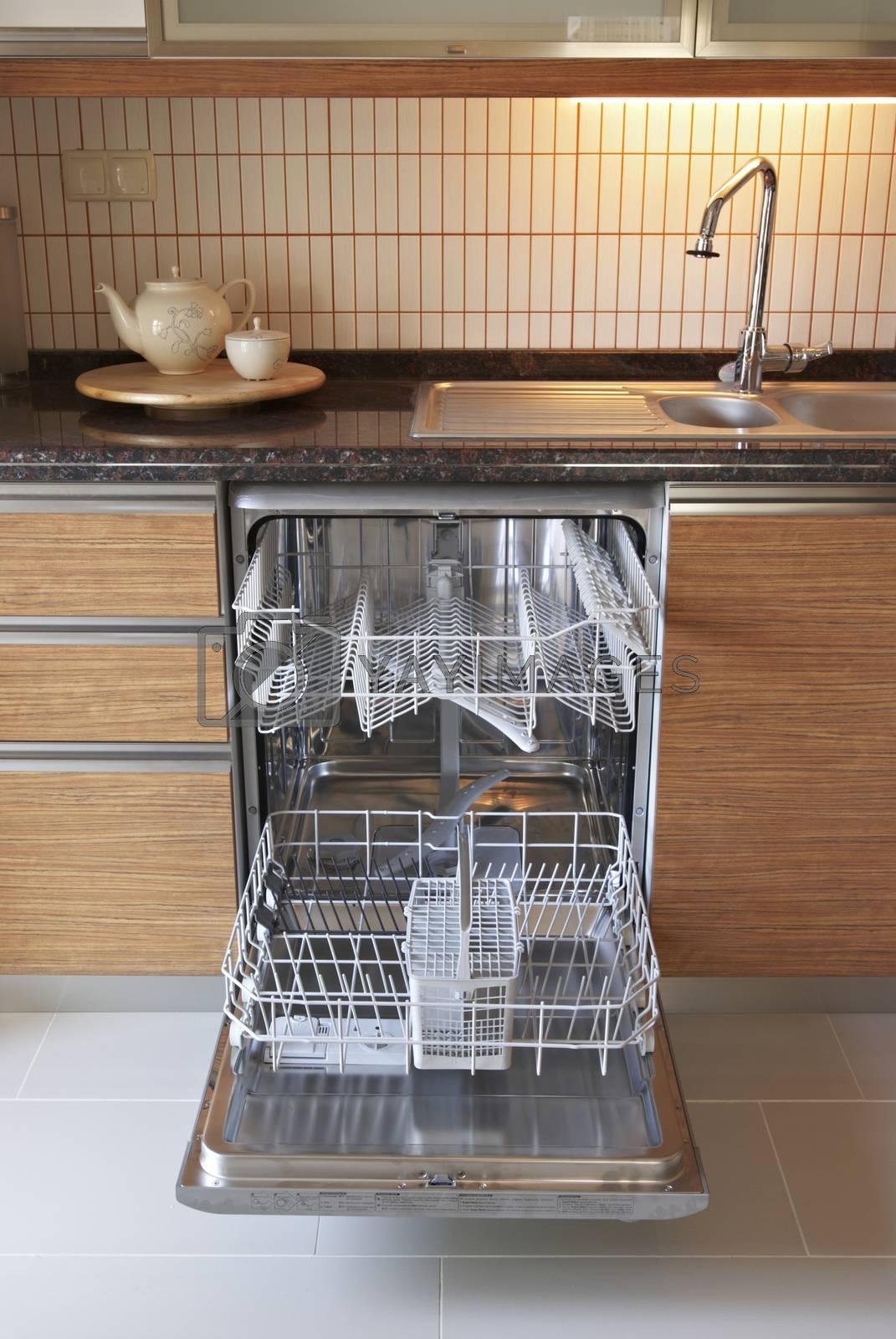 Royalty free image of dishwasher by emirkoo