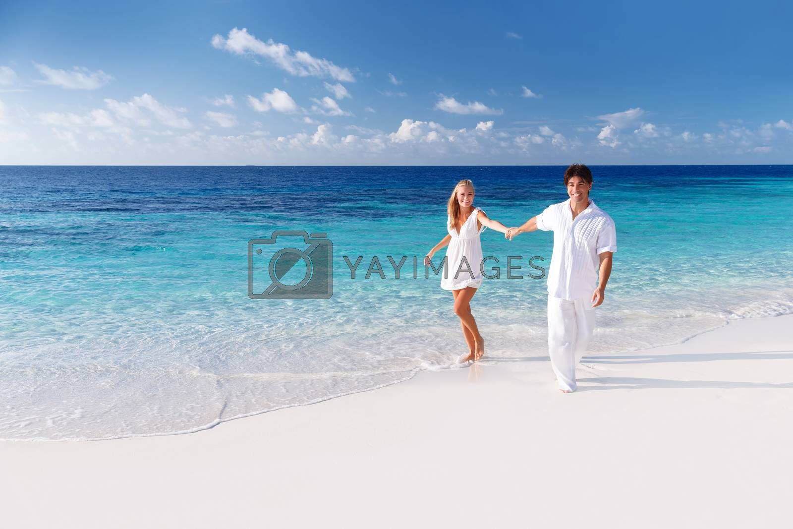 Royalty free image of Happy couple on the beach by Anna_Omelchenko