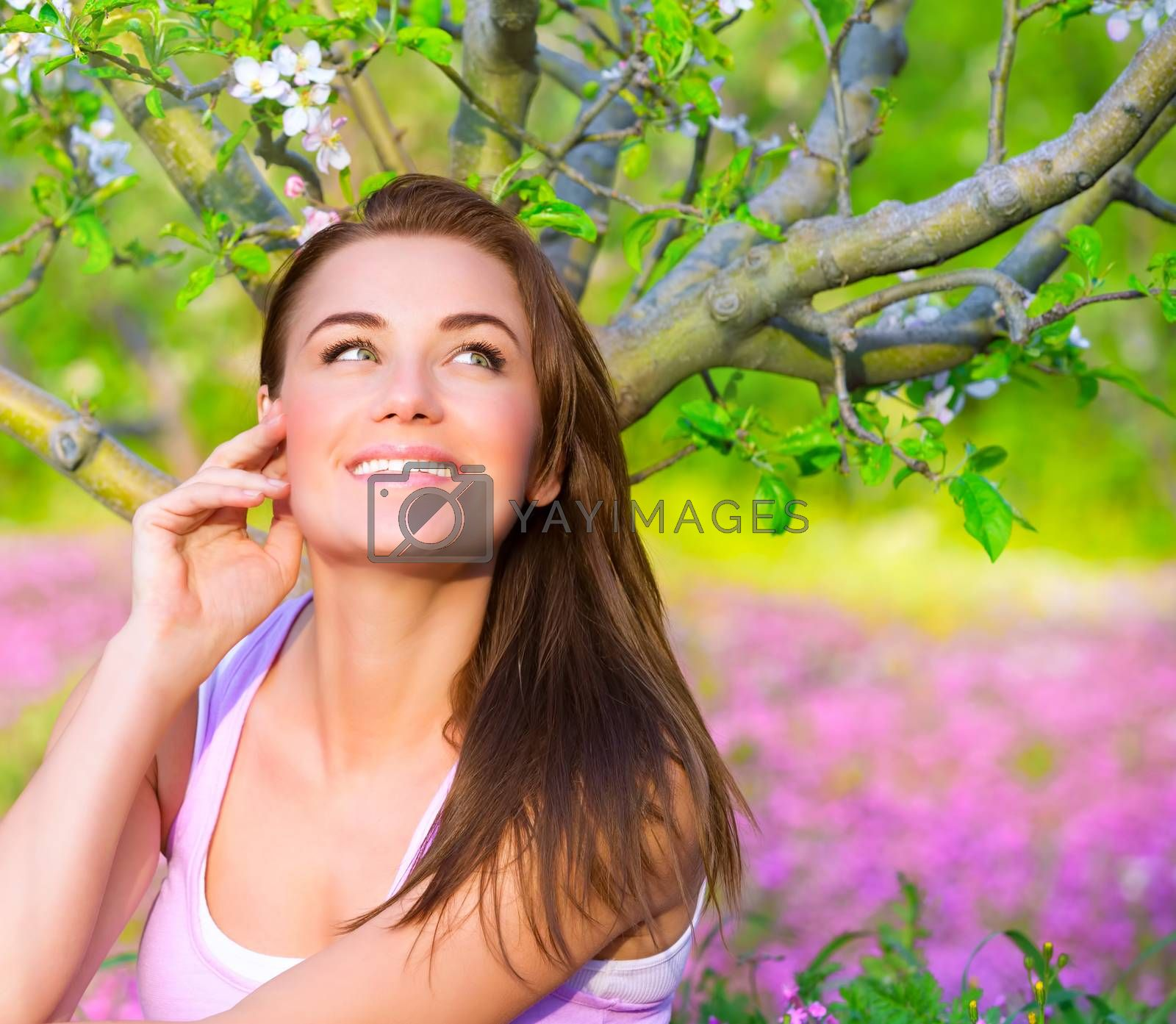 Royalty free image of Happy woman in blooming garden by Anna_Omelchenko