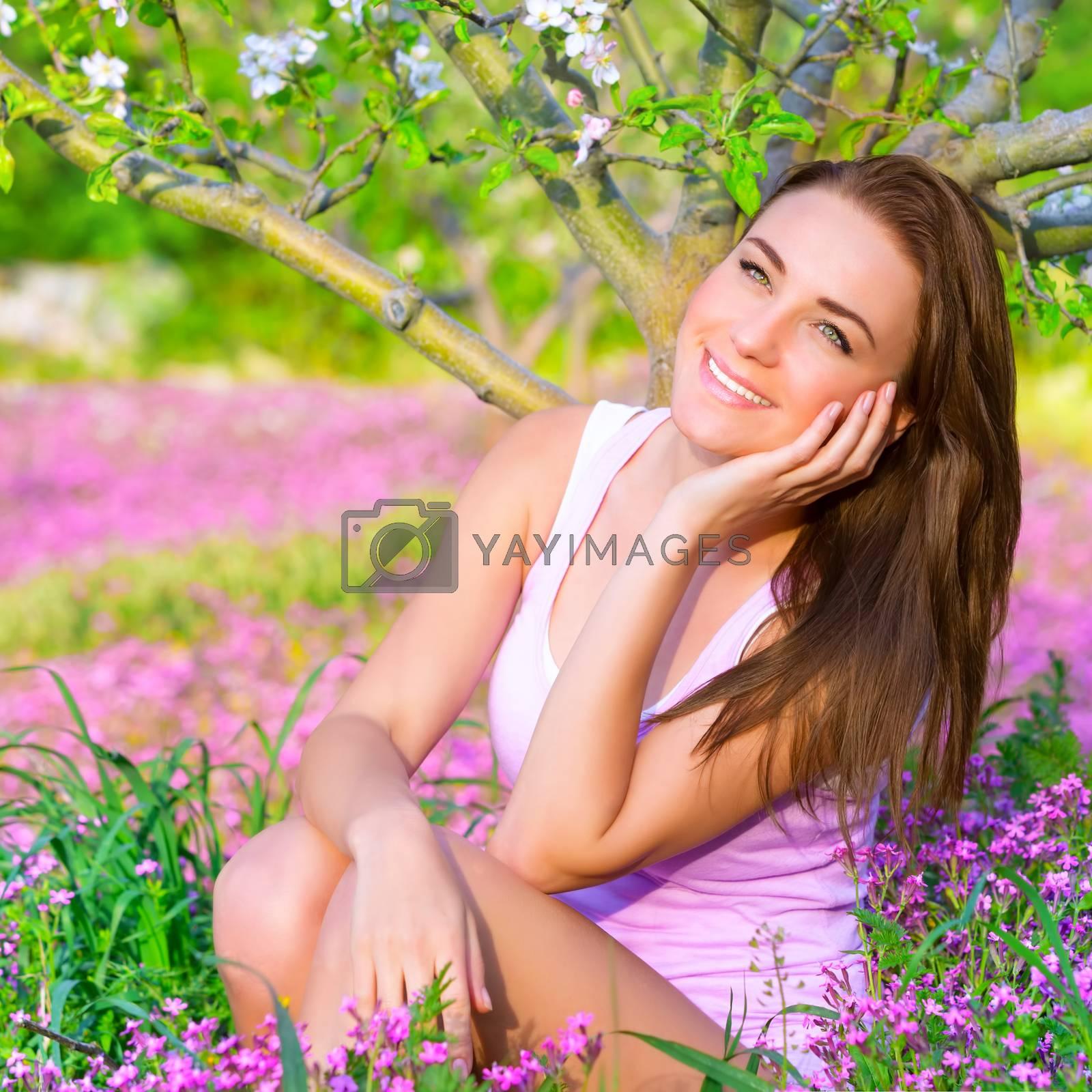 Royalty free image of Dreamy girl in spring garden by Anna_Omelchenko