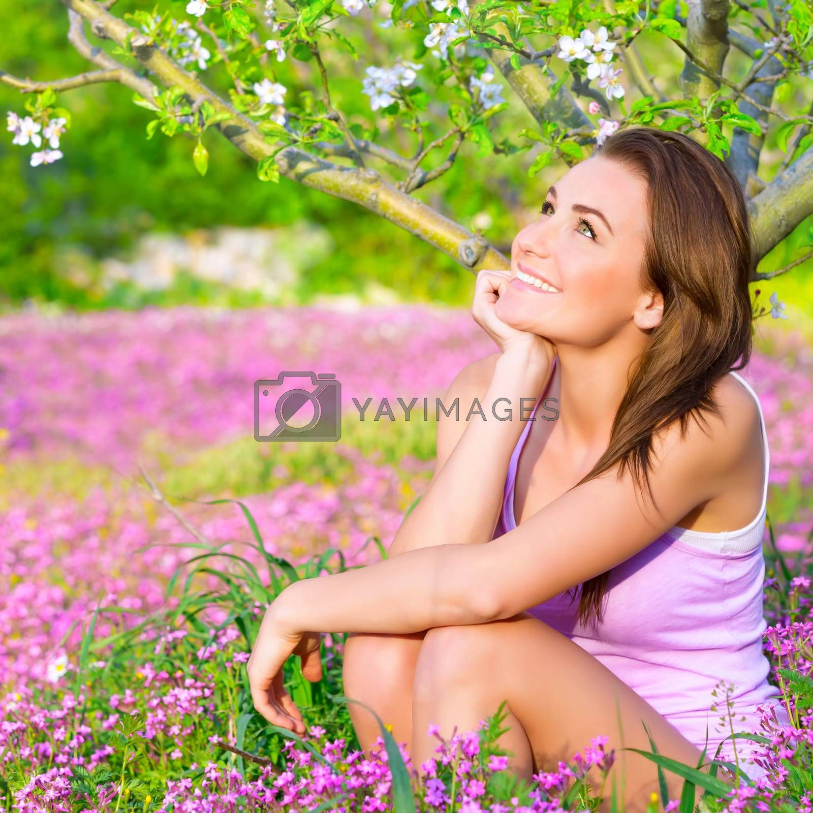 Royalty free image of Dreamy woman in blooming park by Anna_Omelchenko