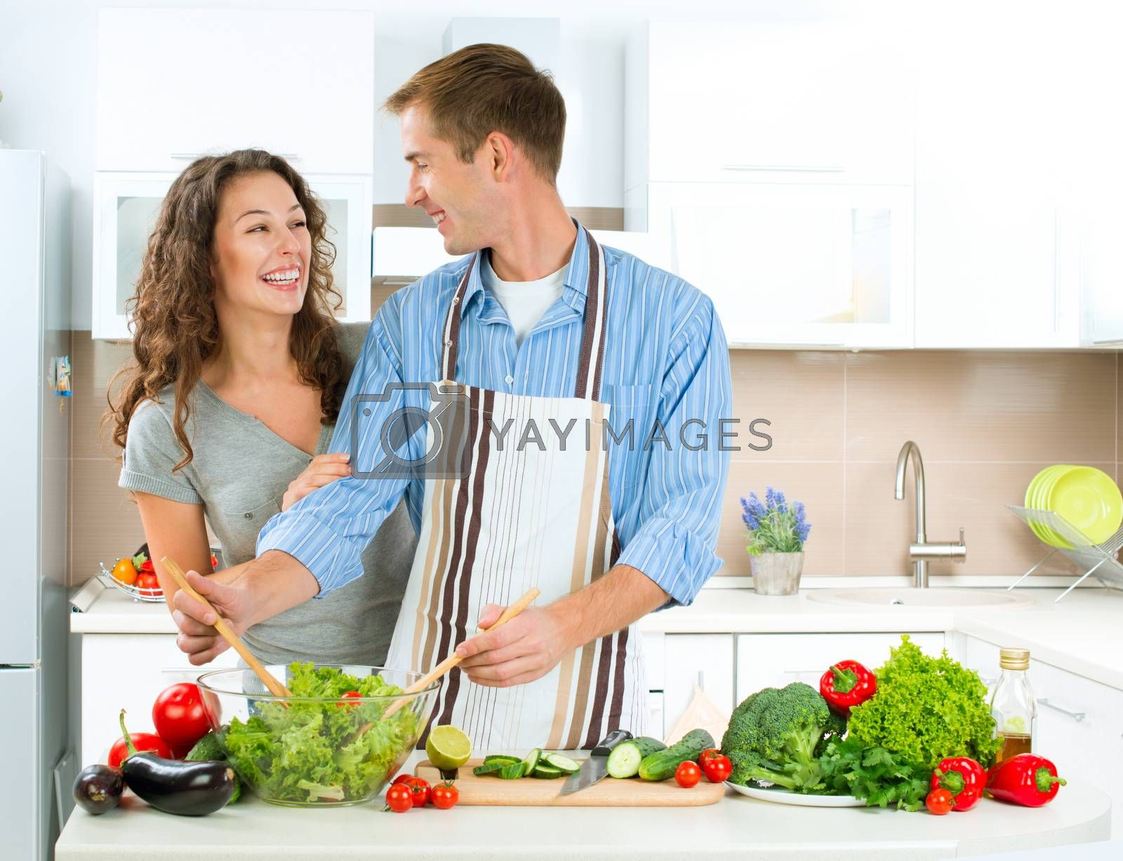 Happy Couple Cooking Together. Dieting. Healthy Food by SubbotinaA