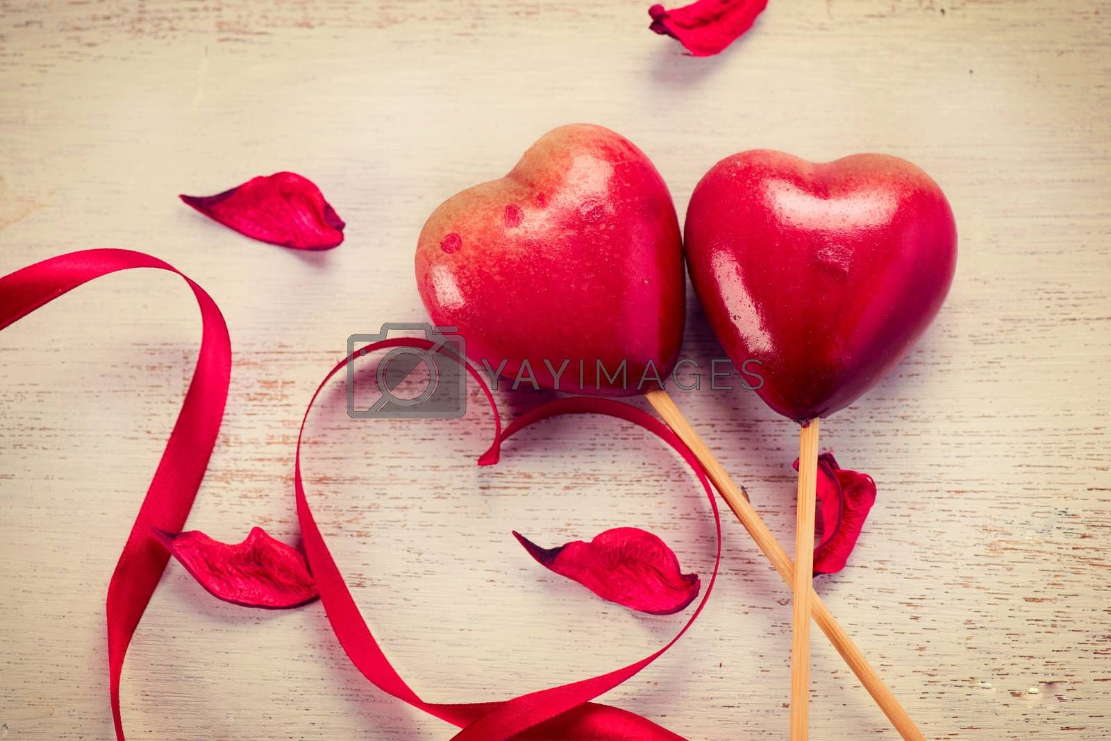 Elegant red satin ribbon and couple of red hearts