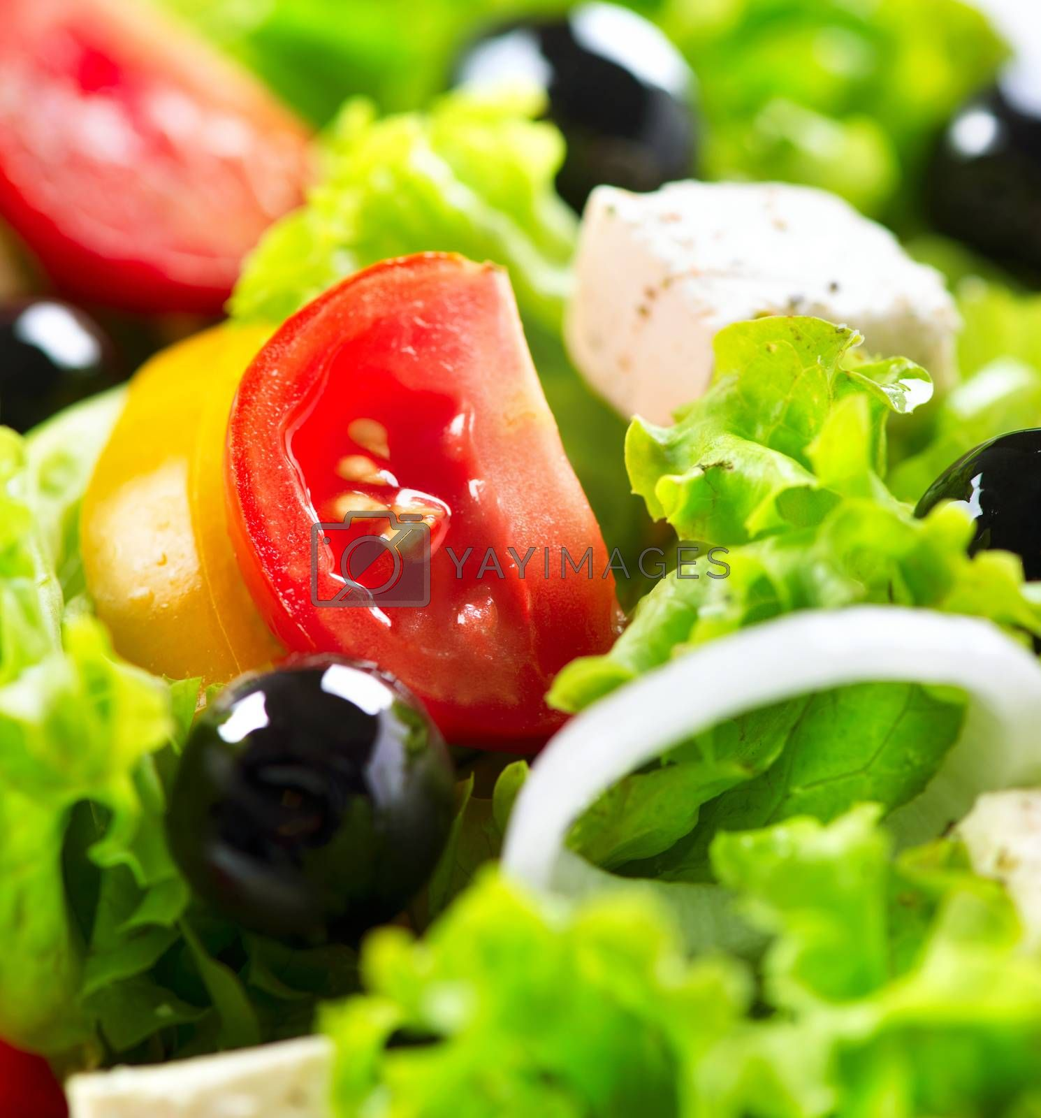 Greek Salad closeup with Feta Cheese, Tomatoes and Olives