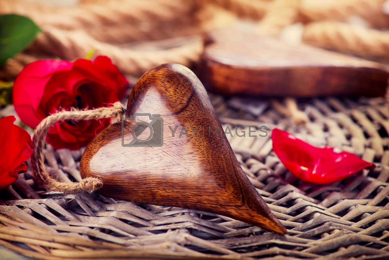 Valentine's Day. Wooden heart over wood background by Subbotina Anna