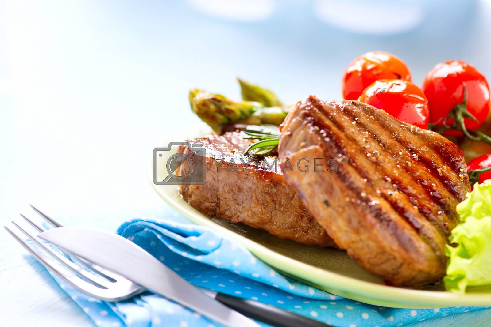 Steak. Grilled Beef Steak Meat with Vegetables