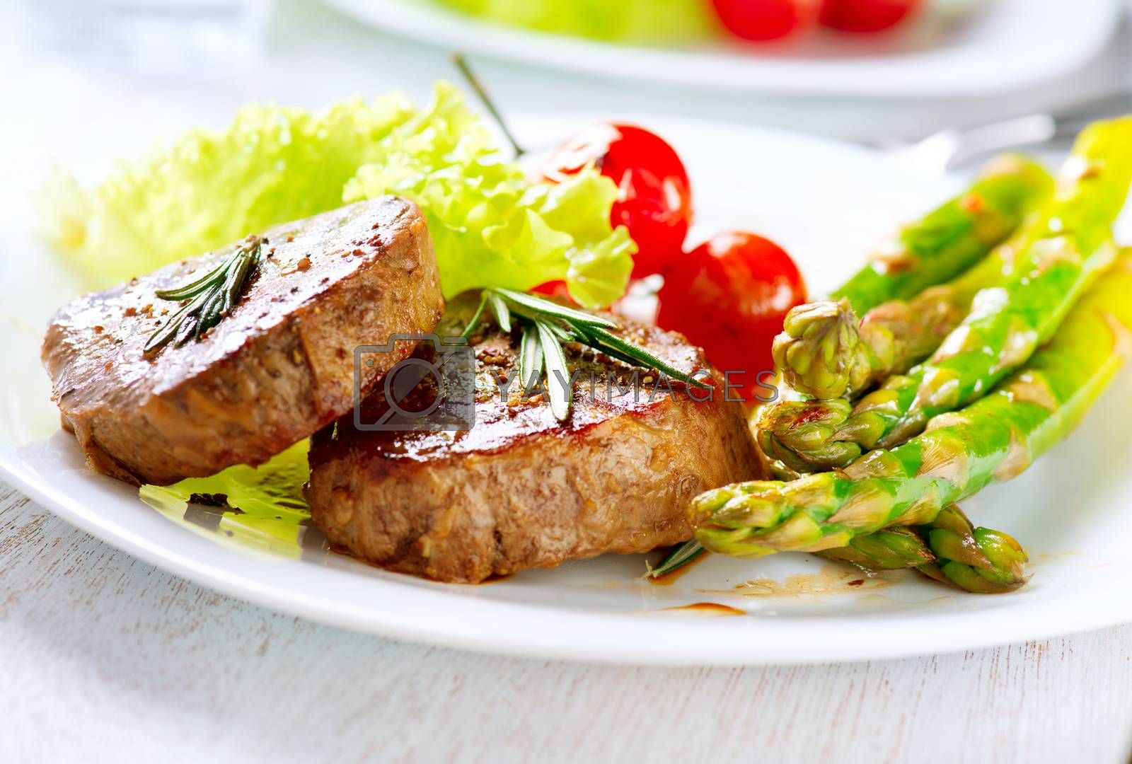 Grilled Beef Steak Meat with Asparagus and Cherry Tomato by Subbotina Anna