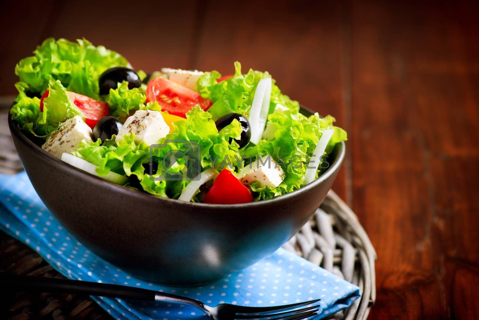 Greek Salad Bowl with Feta Cheese, Tomatoes and Olives by Subbotina Anna