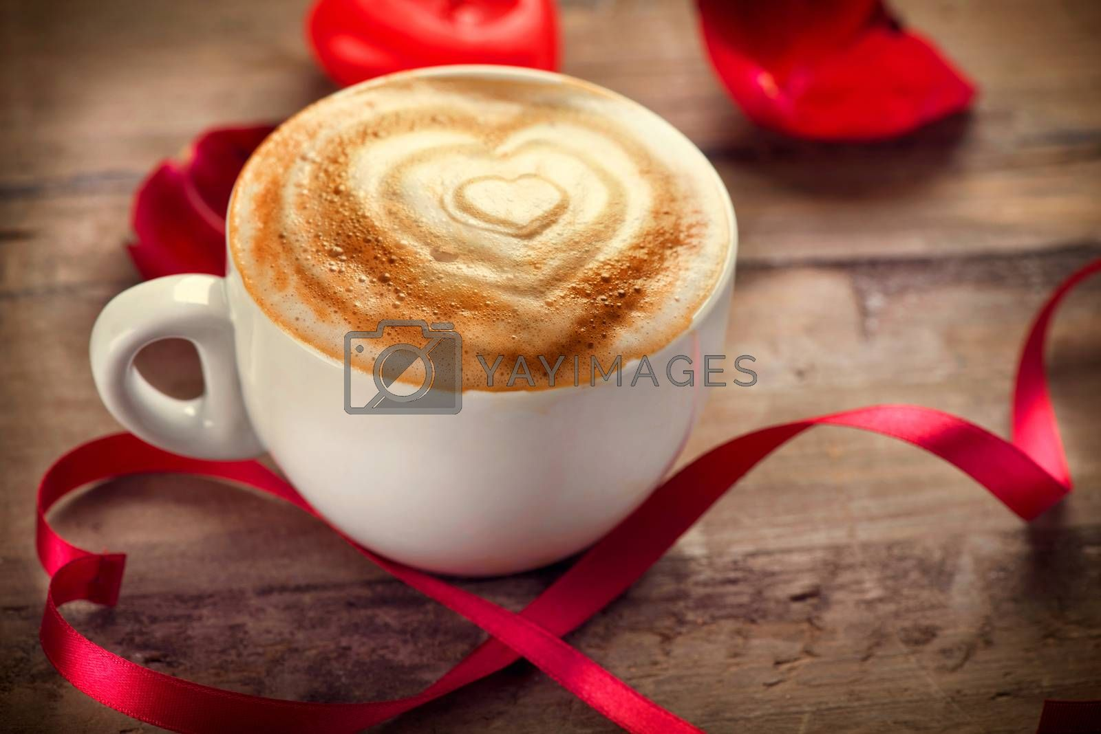 Valentine's Day Coffee or Cappuccino with heart on foam by SubbotinaA