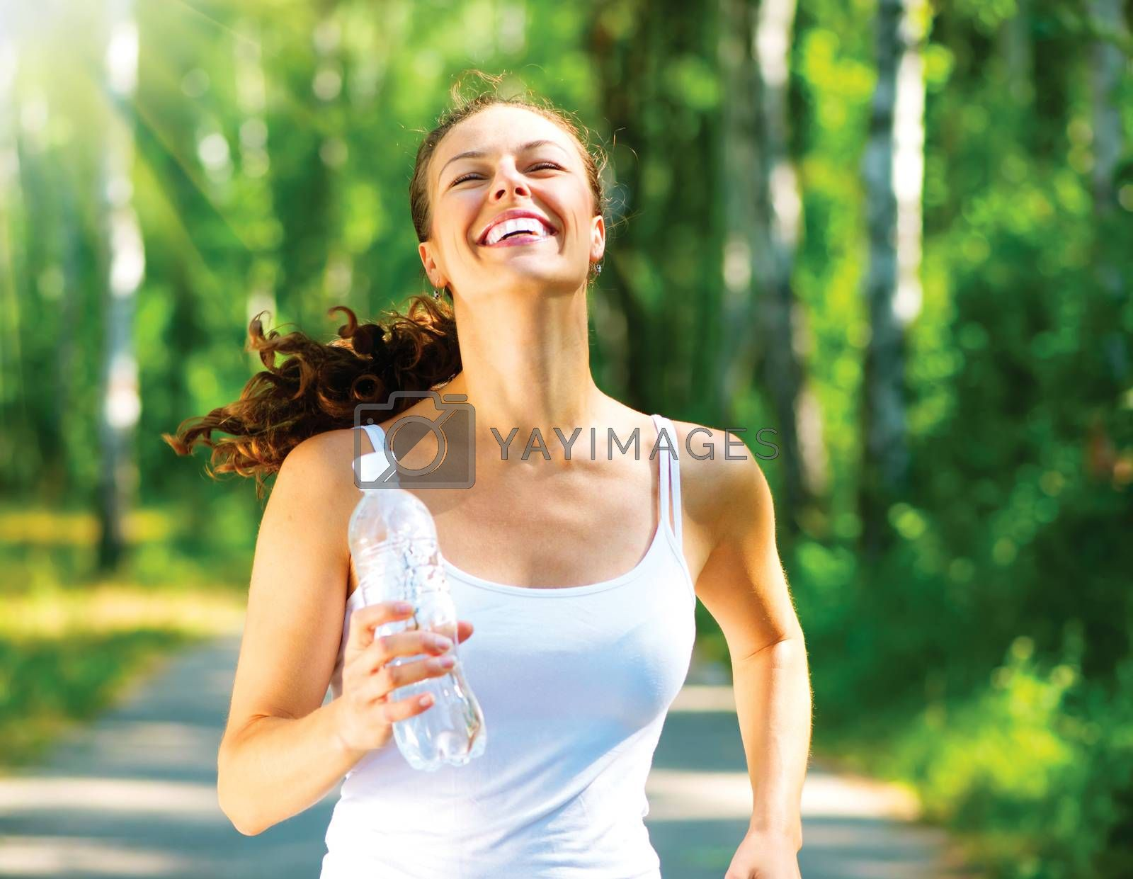Running woman. Female Runner Jogging in a Park by SubbotinaA