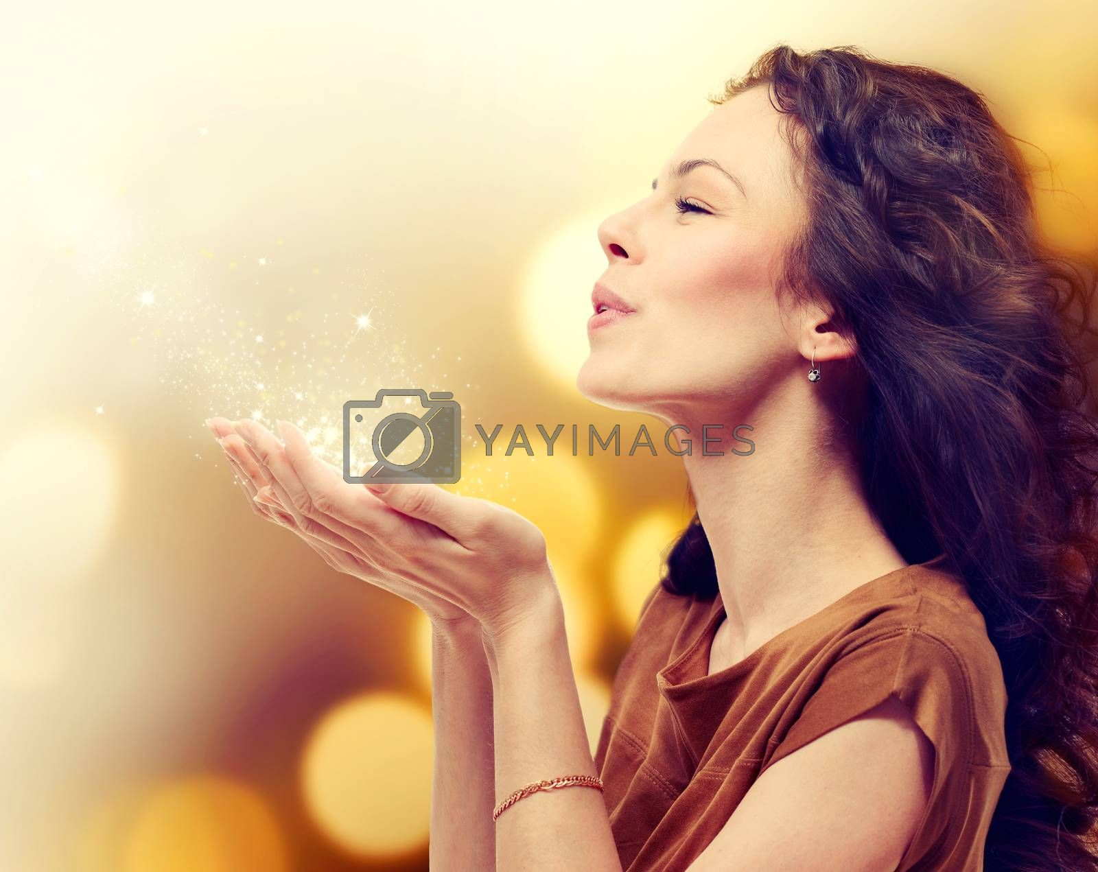 Young Woman Blowing Magic Dust with Stars from her Hands by SubbotinaA