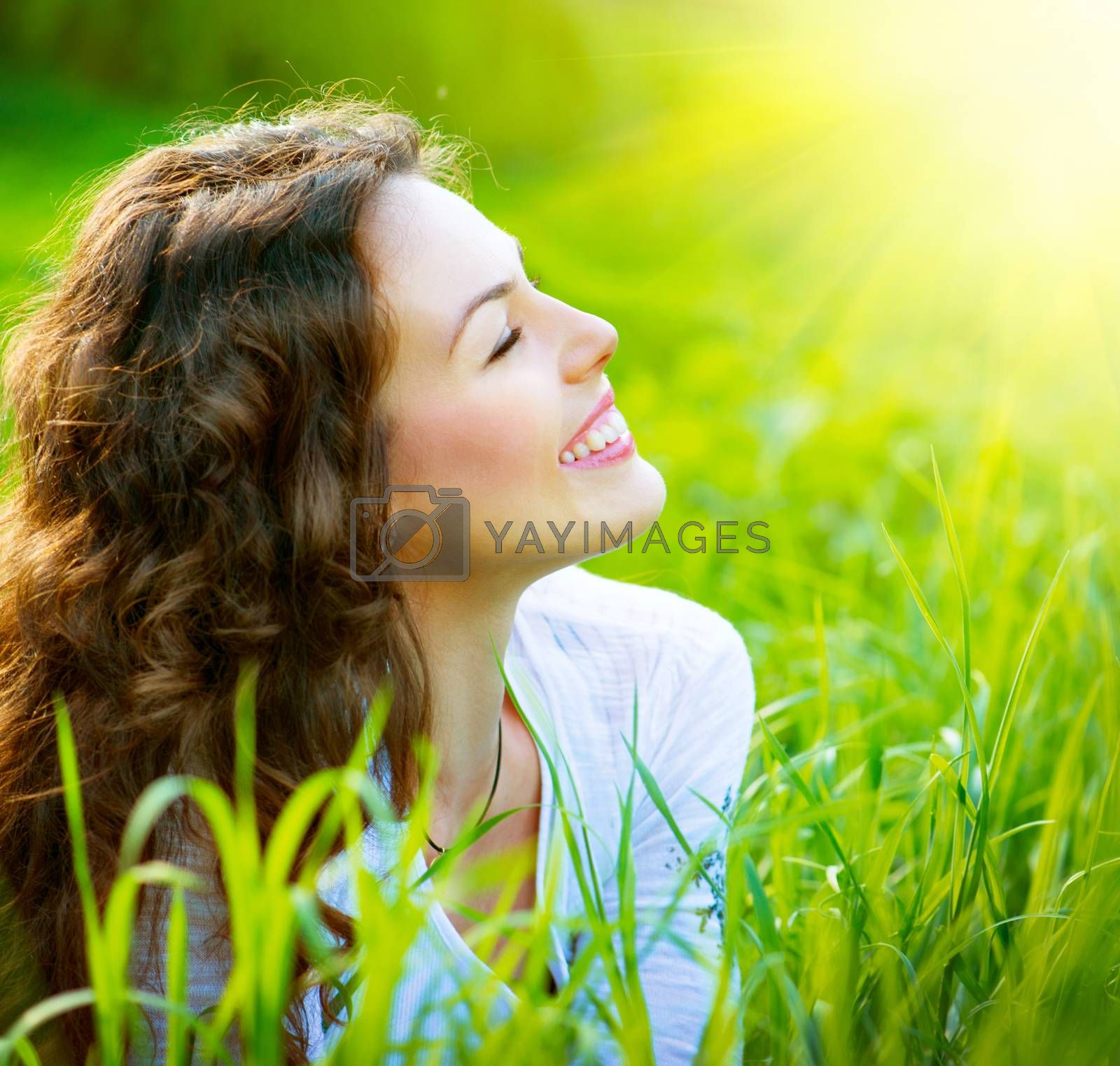 Beautiful Spring Young Woman Outdoors Enjoying Nature by SubbotinaA