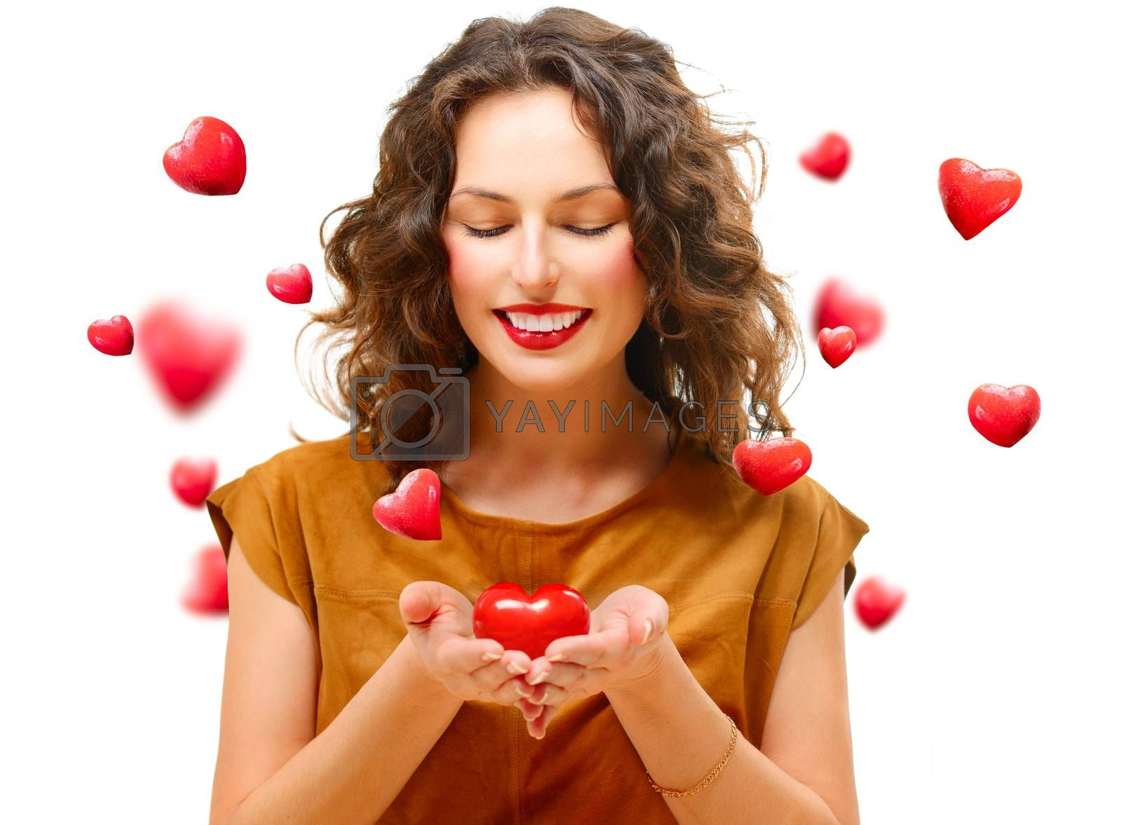 Beauty Young Woman with Valentine Heart in her Hands