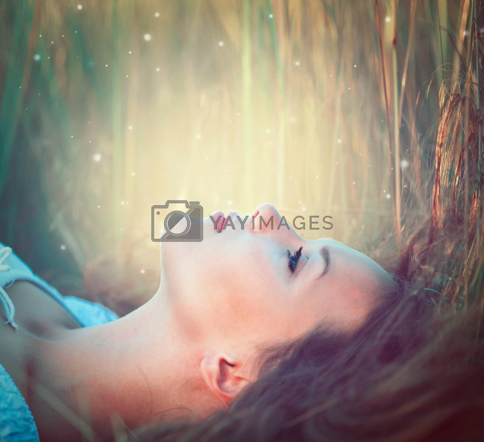 Teenage model girl outdoors enjoying nature