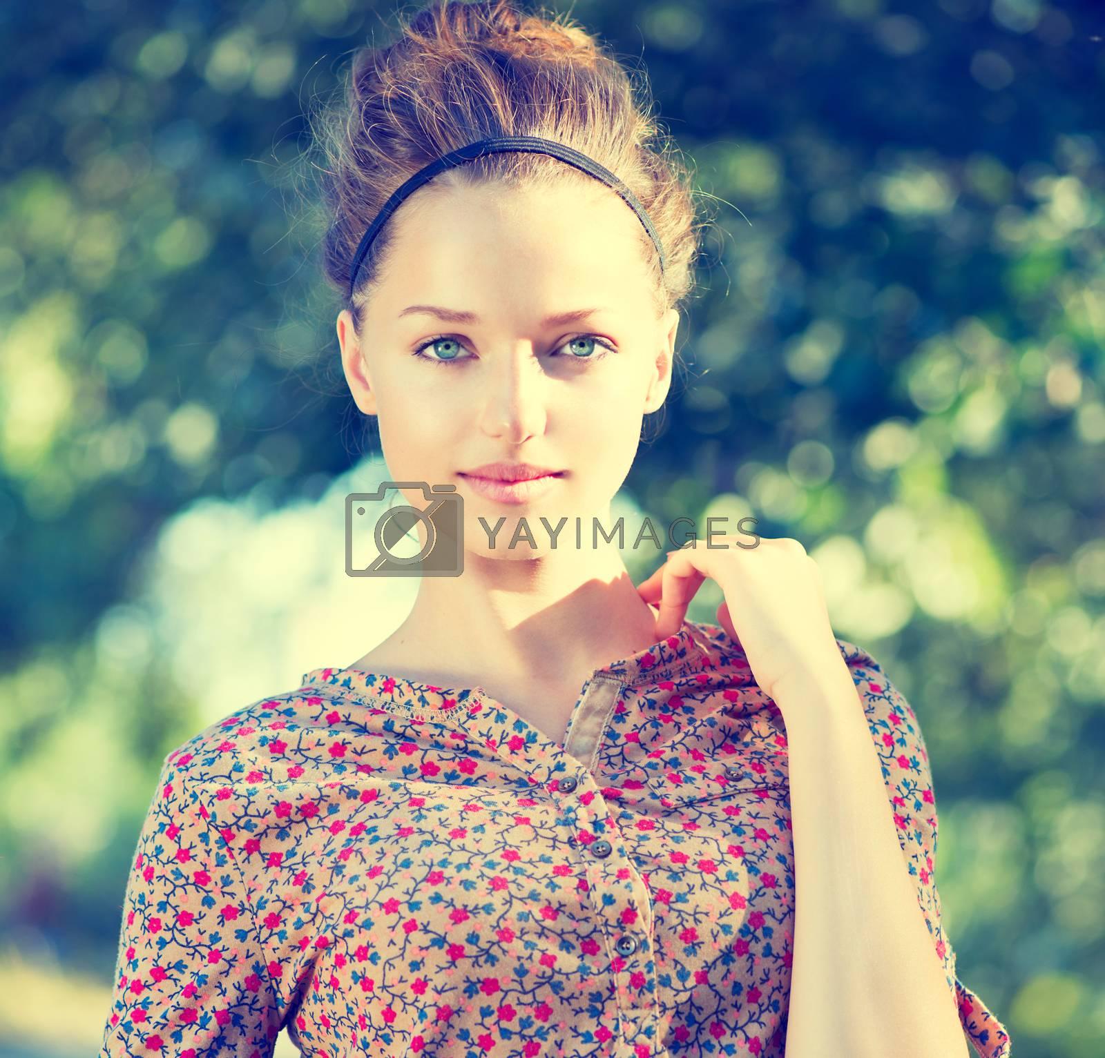 Beauty Teenage Model Girl over Nature Green Background by SubbotinaA