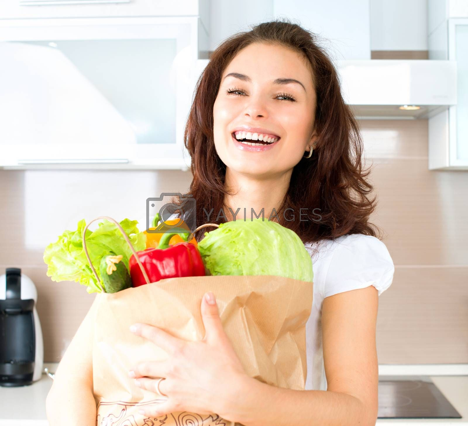 Happy Young Woman with Vegetables in Shopping Bag. Diet Concept  by SubbotinaA