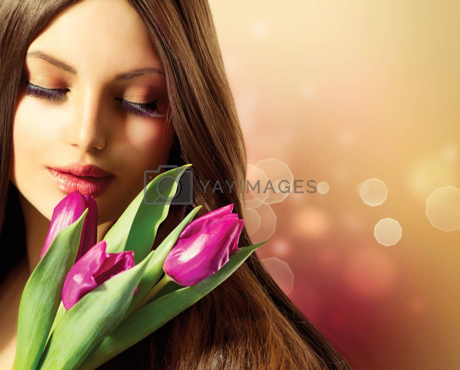 Royalty free image of Beauty Woman with Spring Flower bouquet by SubbotinaA