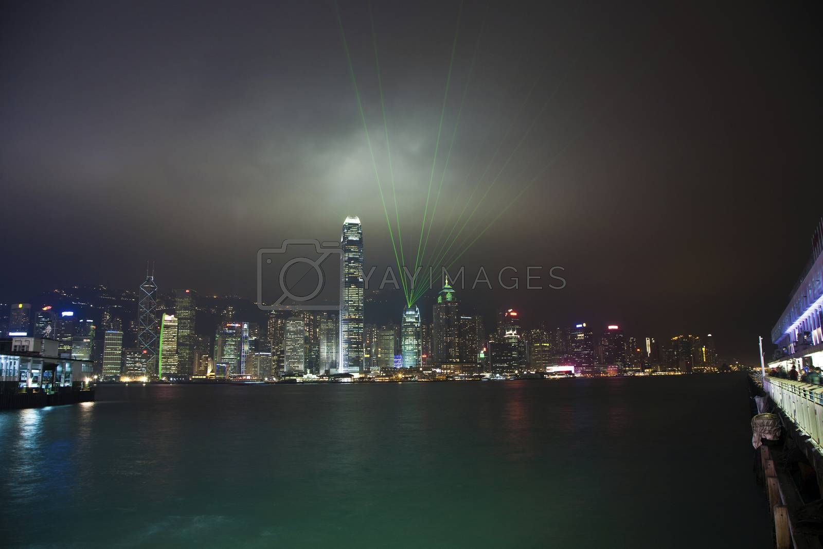 Royalty free image of Hong Kong skyline at night with laser beams  by meinzahn