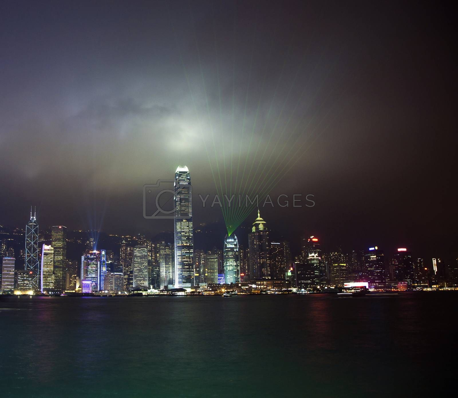 Hong Kong skyline at night with laser beams  by meinzahn