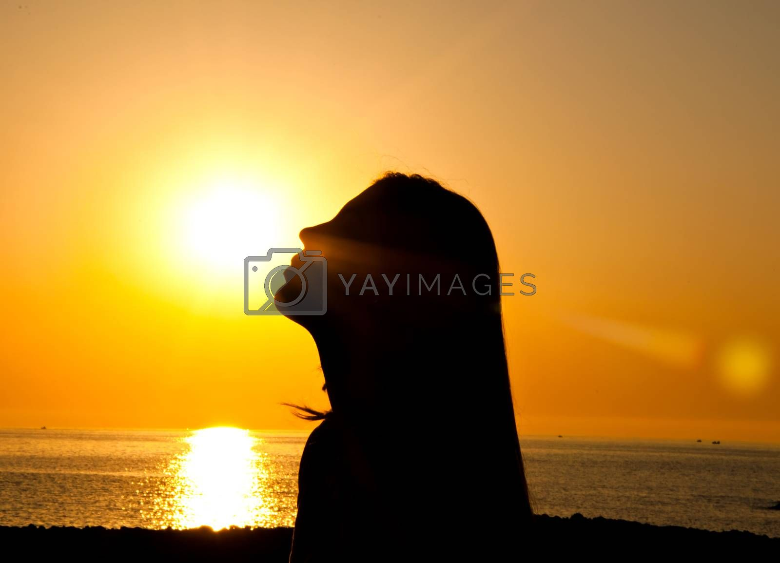 Royalty free image of  Woman silhouette in the sun by lussoadv