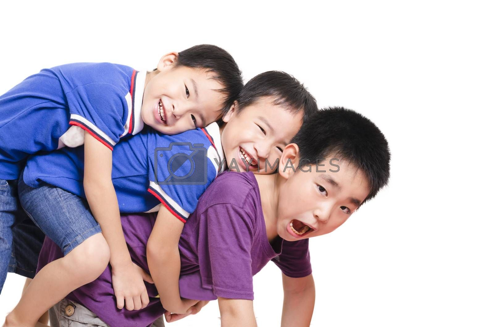 Royalty free image of Three kid stack together by FrankyLiu