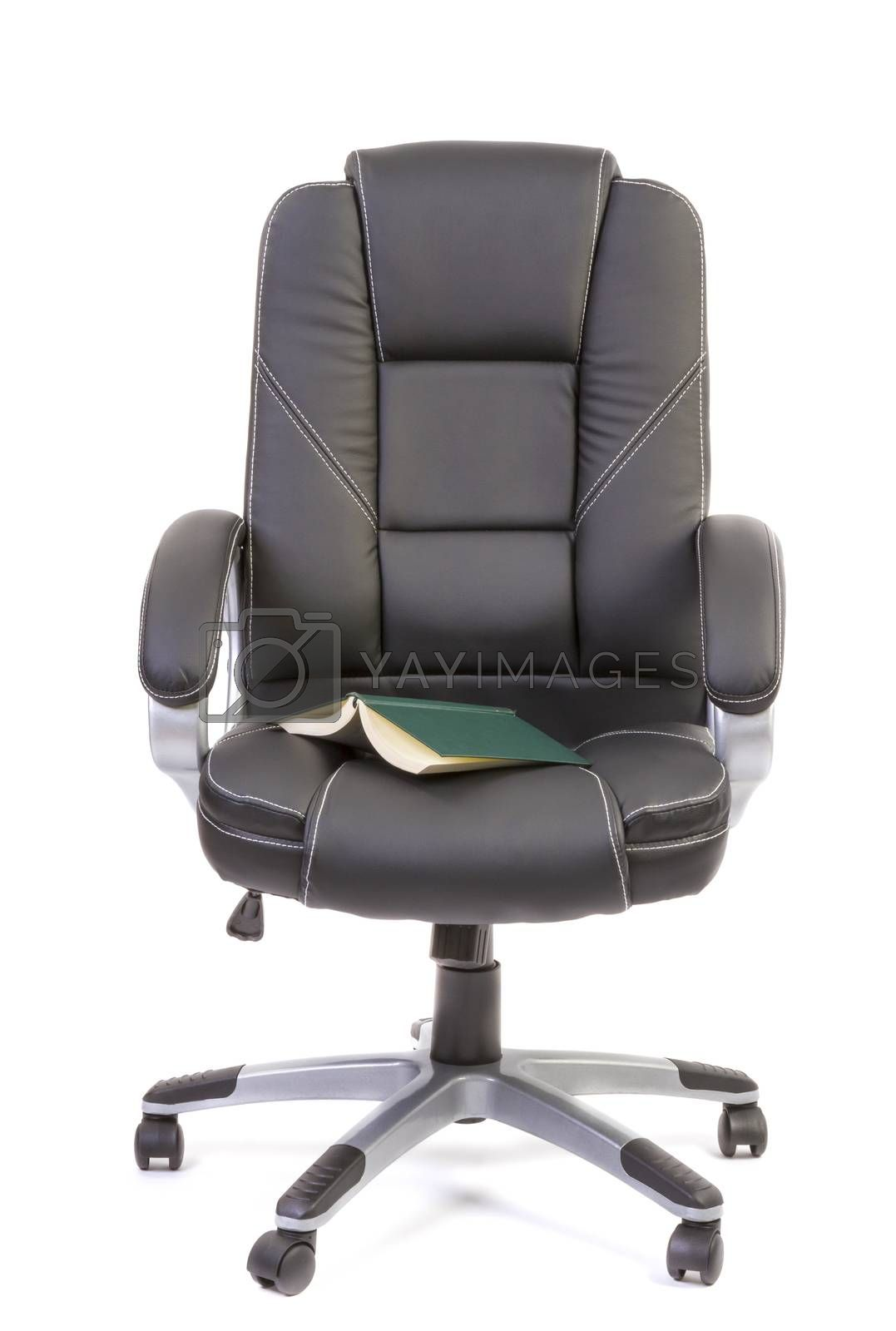 Book on office chair by manaemedia