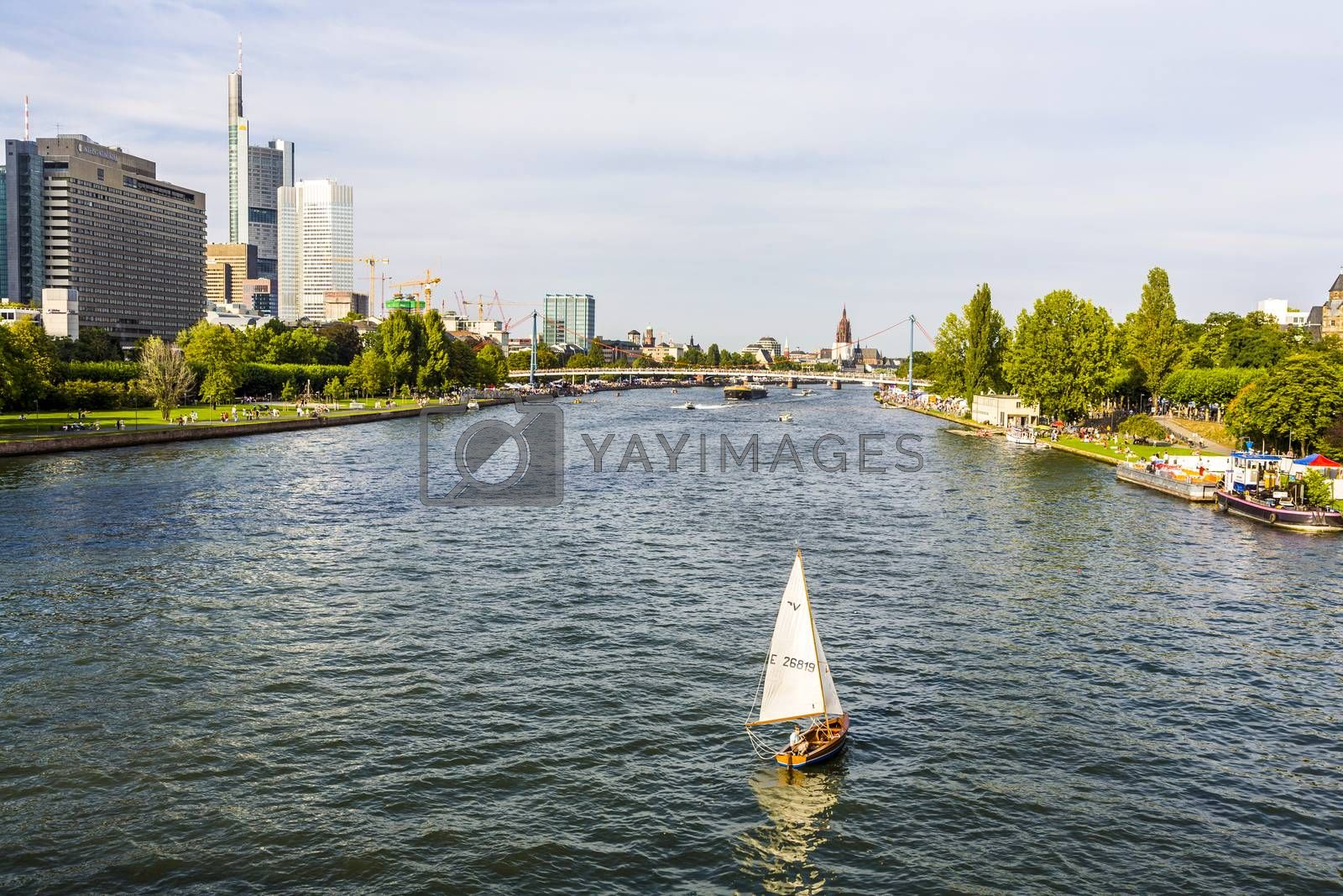 Royalty free image of  view to river main with boat and skyline of Frankfurt by meinzahn