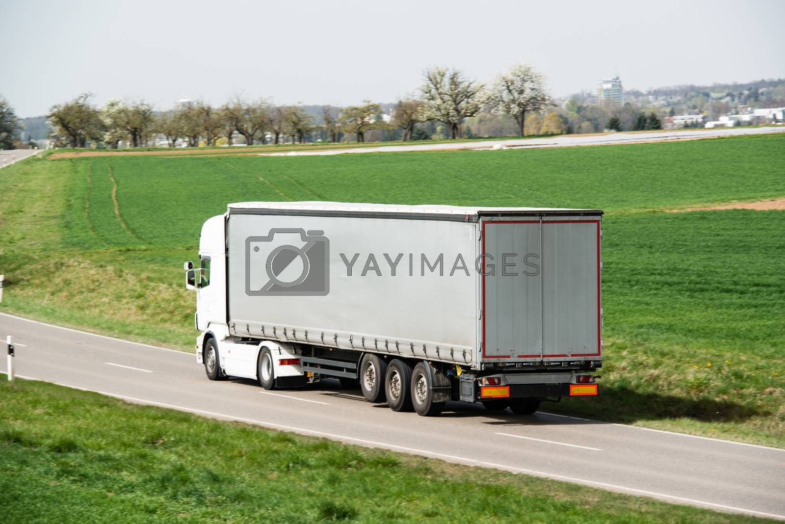 Royalty free image of White truck moving on a main road by franky242